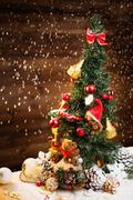 Stock Photo of christmas still life with teddy bears decorating tree