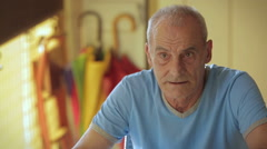 old man taking pill:  disease, care, therapy, tablet, pill, water - stock footage