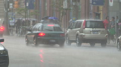 Torrential rain storm in downtown Toronto  people running to safety and cover. Stock Footage