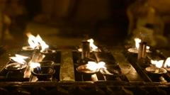 Small oil lamps in buddhist temple Stock Footage