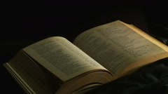old book in the darkness - stock footage