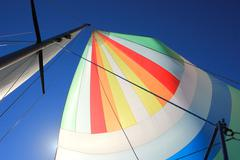 The wind has filled colorful spinnaker sail Stock Photos