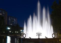 Fountain night city Stock Photos