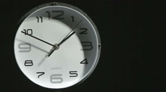 Modern clock on dark background: time, watch, timepiece Stock Footage