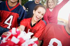 tailgating: friends cheering for football team - stock photo