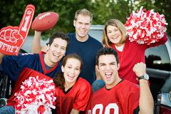 tailgating: group of football fans cheering for team - stock photo