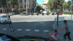POV Pedestrian crossing, lights change and a mother & child race in front of bus Stock Footage