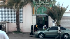Muttrah (Matrah) Oman sultanate 016 citizens go into mosque Stock Footage