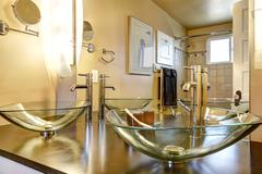 Bathroom vanity cabinet with glass vessel sinks Stock Photos