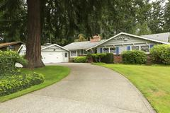house with driveway and landscape - stock photo