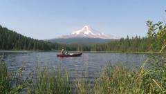 Father and Son in Red Canoe at Mountain Lake Stock Footage