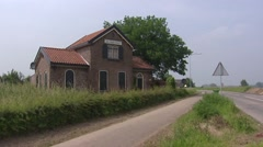 Dike cottage called DE DIJKSTOEL, a storage shed for equipment maintaining dikes Stock Footage