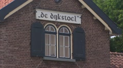 Name plate dike cottage called DE DIJKSTOEL storage shed  + zoom out Stock Footage