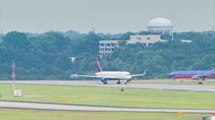 Airplanes Lined-up at Runway to Depart Atlanta ATL Stock Footage