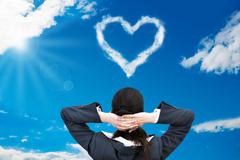 Rear view of relaxed businesswoman looking at heart shaped cloud in blue sky Stock Illustration