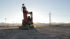 Mini Track Ho Sunset Construction Stock Footage