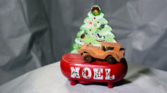 Christmas scene 'noel' wind-up wooden car and music Stock Footage