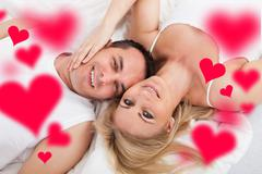 happy couple lying on bed - stock illustration