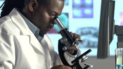 Male Scientist Looking through Microscope - Pan and tilt Stock Footage
