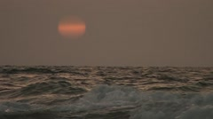 A sun sits down at-sea in a speed-up variant Stock Footage