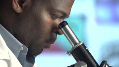 Male Scientist Looking through Microscope - Pan and tilt, close up - stock footage