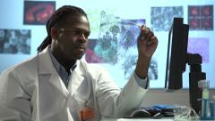 Male Scientist looking at transparency - pan and tilt - stock footage