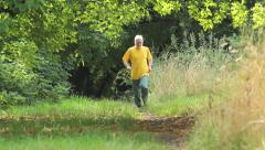 Jogging in the forest Stock Footage