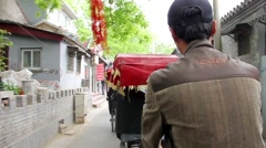 Rickshaw drivers traveling with tourists around Beijing, China Stock Footage