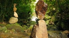 Zen meditation and relaxation nature background of rock towers in tropical garde Stock Footage