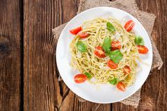 portion of spaghetti with pesto - stock photo