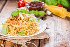 spaghetti with tomato pesto - stock photo