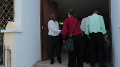Man in Wheelchair is Helped in to Church in Cuba Stock Footage