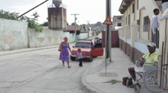Woman walks into Church in Cuba Stock Footage