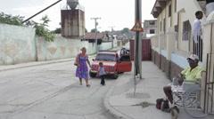 Woman walks into Church in Cuba Stock Footage