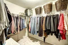 walk-in closet with clothes - stock photo