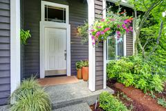 entrance porch with white door - stock photo