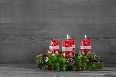 Advent wreath or crown with four red candles on wooden background. Stock Photos