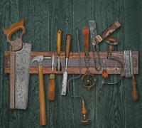 vintage woodworking tools on a wall - stock photo