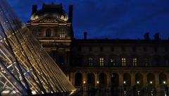 People visiting louvre museum at  night 4k uhd Stock Footage
