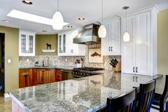 Modern house interior. kitchen room with shiny granite tops and mosaic trim Stock Photos
