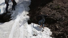 Children Enjoying Playing in the Summer Glacier Snow Stock Footage