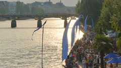 People walking along the seine river Stock Footage