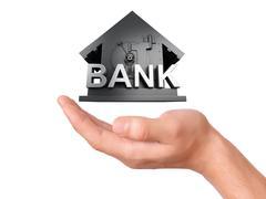 Hand holding bank safe on white background Stock Illustration