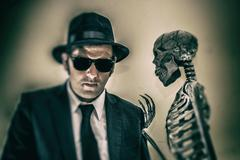 Man Taking Advice from a Skeleton Stock Photos