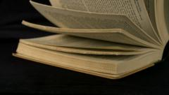Old book's page turning, Slow Motion Stock Footage