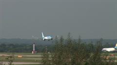 Budget passsenger pland landing on runway Stock Footage