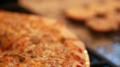 Hot pizza out of the oven in the kitchen Stock Footage
