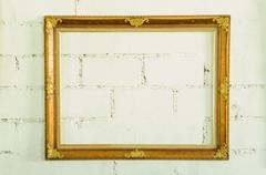 Vintage gold picture frame on white wall Stock Photos