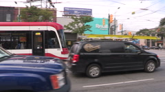 Cars and transit streetcar on busy Toronto city street Stock Footage