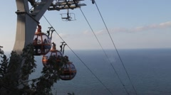 Cable car on the background of the Mediterranean Sea. Shooting through the windo Stock Footage